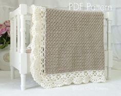 Crochet pattern for the simply elegant Claire crochet baby blanket with intricate edging, the perfect DIY gift for a baby shower or a family keepsake.