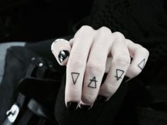 Elements tatto. (This always reminds me of Ruki from the GazettE)