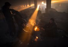 Migrants rest by the fire inside a makeshift shelter in an abandoned warehouse in Belgrade, Serbia; a commuter jumps between trains upon arrival at a station, to attend Akheri Munajat, the final supplication during Biswa Ijtema in Tongi, on the outskirts of Dhaka; and Afghan people gather around a fire to beat the cold as winter season approaches, in Herat, Afghanistan are some of the photos of the day. (AP/EPA/Getty/Reuters) See more news-related photo galleries and follow us on Yahoo News…