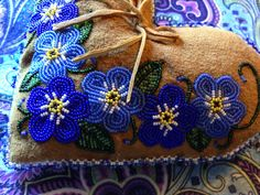 Beaded forget me not ring pillow on moosehide, Alaska native beadwork. By Liisia Carlo Edwardsen