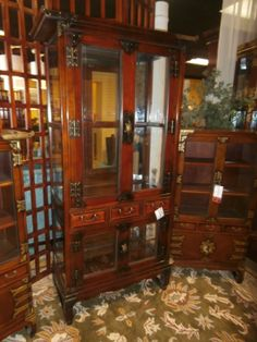 Asian styled cabinet with three drawers and glass doors. Measures 36 x 16 x 68. At the time of posting, we have quite a few similar pieces consigned if you love this style. Arrived: Wednesday October 5th, 2016