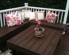 We love the idea of building a table and bench into a deck. You can also use it as storage if needed.
