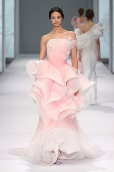 Pale ivory with hand painted pink dégradé silk organza gown featuring layers of ruffles.