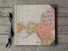 IONA BINDING - • Handmade photo album that measures 10,43 x 9,60.  • The covers are made with 0,09 book board covered with a mapamundi illustration.  • It