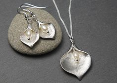 Silver Pearl Jewellery Set - Calla Lily earrings and necklace with freshwater Pearls. by MistyOceanGems on Etsy https://www.etsy.com/listing/400767345/silver-pearl-jewellery-set-calla-lily