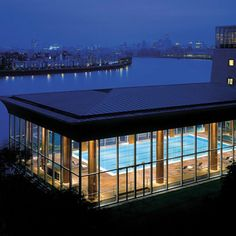 The swimming pool and view of the River Thames at the Four Seasons hotel in Canary Wharf, London