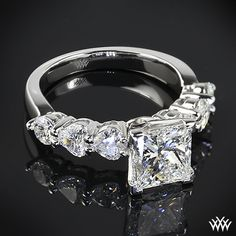 This beautiful Custom Diamond Engagement Ring is set in platinum feature 2 A CUT ABOVE® Hearts and Arrows Diamond Melee combined with 4 Heart Cut Diamonds along the shank. The lovely 4 prong head holds a dazzling 2.30ct Premium Select Princess Cut Diamond.