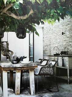 An outdoor kitchen can be an addition to your home and backyard that can completely change your style of living and entertaining. Earlier, barbecues temporarily set up, formed the extent of culinary attempts, but now cooking outdoors has become an. Outdoor Living Rooms, Outdoor Dining, Indoor Outdoor, Outdoor Decor, Dining Area, Outdoor Retreat, Rustic Outdoor, Patio Dining, Outdoor Seating