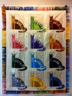 colorful sawtooth cats quilt