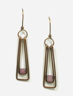 Copper wire dangle earrings with pink/purple dyed jade cube beads. The simple lines are great for daily wear or that special night out.  The frame work has been hand shaped specifically for the cube b