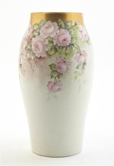 A Limoges Porcelain Vase, Tressemann & Vogt,  of elongated ovoid form with foliate and gilt decoration.  Height 12 3/4 inches.  Estimate $ 300-500  Leslie Hindman Auctioneers  Sale 217 Lot 2132  Property from the Estate of Samuel and Dora Kaner, Southfield, Michigan