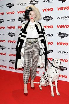 The Best Celebrity Halloween Costumes Of All Time #refinery29 http://www.refinery29.com/2016/09/122480/best-celebrity-halloween-costumes-2016#slide-18 Iggy Azalea As Cruella de Vil, 2013Trust Iggy to bring along an actual Dalmatian to complete this costume....