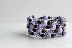 Hey, I found this really awesome Etsy listing at https://www.etsy.com/listing/159014940/lilac-purple-black-and-silver-glass