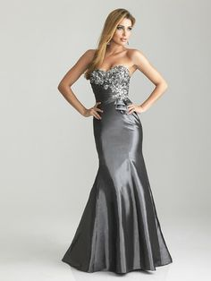 A classic evening gown design in charcoal grey from Night Moves.