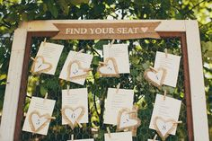 Vintage screen door or window upcycled for seating chart    Photography by annajayephotography.com