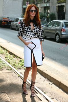 In a slit-to-there mini, graphic-print blouse and strappy sandals, she's a veritable smoke show // Taylor Tomasi Hill