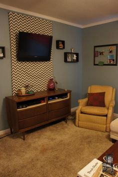 Hide Your TV Cords By Building A Frame With Fabric You Like On It - Creative and stylish solution to hide electrical wires cluttering a room