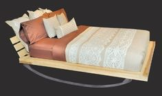 """""""Flex Bed Double Full in Natural by Shiner"""", $2,975 for the Double, $3,325 for the Queen, $3,675 for the King, homeandliving. The curved metal base gives this #wood #bed a rock and roll twist. #rockingbed"""