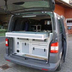 Custom Campers - rear storage pull outs