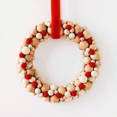 Ring in the season with a graphic riff on the traditional wreath. - FamilyCircle.com (wooden bead wreath for Christmas)