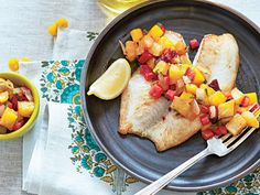 Grilled Pineapple-Mango Salsa | Pineapple and onion are grilled until slightly caramelized, adding a complex sweetness perfect for meats, like grilled pork, or mild grilled fish such as flounder, catfish, or tilapia.