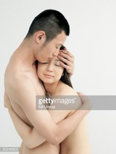 Stock Photo : Man and woman embracing in studio, nude
