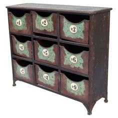 """Stow yarn in the sewing room or dry goods in the kitchen using this 9-drawer metal storage chest, showcasing a weathered finish and industrial-chic design.    Product: ChestConstruction Material: MetalColor: Brown and greenFeatures:  Industrial-chic designNine numbered drawers Dimensions: 23.5"""" H x 28.5"""" W x 8"""" D"""