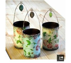 Decoupaged tin cans...These make great fresh-flower or candle holders for a backyard wedding. This DIYer used printed napkins.