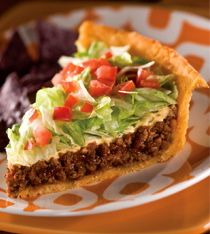 Taco Pie: Crisp, taco seasoned potato crust, layered w ground beef, sour cream, cheese, lettuce & tomato. Delicious for Superbowl Sunday Party.