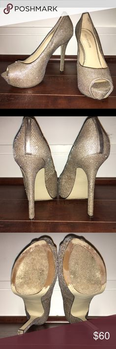 Time to get flashy! These hot peep toe platform pumps will spice up ANY outfit. They are broken in with no flaws or blemishes other than normal wear on the bottoms. These will carry you out on any dance floor 💃 leather with silver woven sparkle material. Enzo Angiolini Shoes Heels