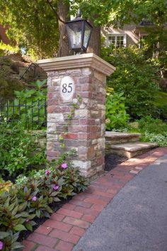 Try brick edging on your driveway to make it more appealing, and incorporate old fashioned brick columns. - This is for brick column & light on single oil co. metal post on left of entry before gates (with other post removed to widen entry, & put mailbox Brick Driveway, Asphalt Driveway, Driveway Design, Driveway Gate, Driveway Posts, Driveway Border, Brick Pavers, Front Gates, Entrance Gates