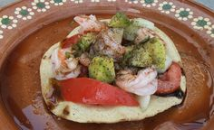 Mexican Tostada Recipe: Shrimp Tostadas from The Riviera Nayarit - If you've never tried them, tostadas are sort of like tacos, only instead of using a tortilla to wrap around the contents of the taco, they use a hard, flat shell that you simply pile the ingredients on top of! They make for a great little afternoon snack or a quick dinner appetizer you can whip up, or even eat them as a meal if you make enough of them.