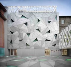 triangulated metal panel facade