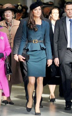 Catherine rocks a teal belted peplum skirt suit by L.K. Bennett, black pumps and a James Lock hat
