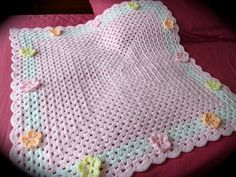 Crochet Baby Blanket in Pink with White Flowery Trim.