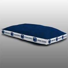 Let your furry friend sleep in style and show off their team spirit with their very own Penn State University Dog Bed by Sports Coverage. Your pet will love taking naps after playtime or sleeping at n