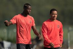 United are taking a strong squad to Holland, including world record signing Paul Pogba, pictured with Dutch winger Memphis Depay (right)