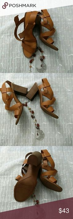 Sarto Brown Open Toe Chunky Heel Strappy 10 You are looking at a new Sarto Franco Sarto Brown Open toe Chunky Heel Strappy Shoe in Size 10M, leather upper, made in China. A-Sabine. Please look at pictures and ask questions before buying. Thanks for looking. Franco Sarto Shoes
