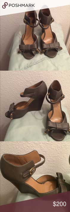 Chloe leather wedges Chloe gray leather bow embellished peep toe wedges.  Contrast stitching throughout and gold tone buckle closures at ankles.  4 inch heel.  Moderate scuffs at soles.  A few nicks at the heel.  I received many compliments with each wear of these wedges. Chloe Shoes Wedges