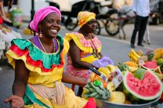 Cartegena, Columbia- can't think of Cartegena without thinking of the ladies with the fruit on their heads! :)