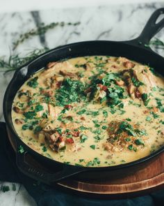 Coq Au Vin Blanc, a hearty & creamy sauce with mushrooms, bacon, and bone-in chicken.  Sub out fat free evaporated milk.