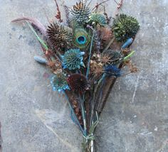 Dried Wild Flower Bouquet Arrangement No.23 Thistles, Sunflowers, Lions Tail, Ginger    A bouquet selection of some of the unlikely wild flowering weeds. This arrangement is for those who see the beauty in the wild flowers, flowering weeds, thistles, thorns and wild field grasses..To consider how lovely and scarcely a common flower among the bunch.    The arrangement may consists of~   Pine Cones ( made to resemble a rose), Bull Thistle, Star Thistle, Lions Tail, Opium Poppy Pods, feathers…