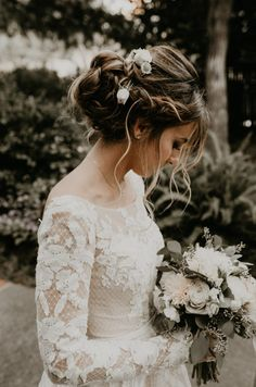 Make any bridal look seem effortlessly elegant with a low chignon do | Image by feather + north