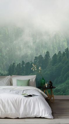 Instil a relaxing aura in your space with this enchanted woodland wallpaper, a misty forest mural that will impress.