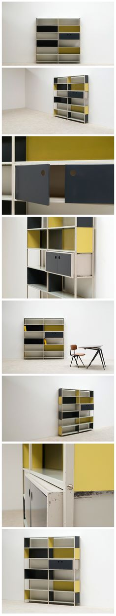 Modular metal shelving unit or wall unit, in 1953 Martin Visser commissioned Friso Kramer to design a simple shelving unit for the Bijenkorf store in Amsterdam Netherlands. Multiple metal shelves where the colored metal (dark blue and yellow) backside can placed at your own composition.
