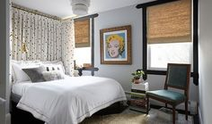 A chic alternative to a hefty headboard, floor-to-ceiling curtains take up virtually no space in this petite bedroom—but still offer maximum visual impact.