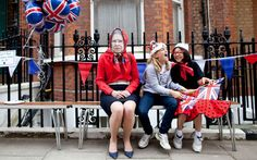 Pupils from Falkner House Girls School in South Kensington, London, enjoy a Jubilee street party, sitting next to one of their teachers dressed as the Queen