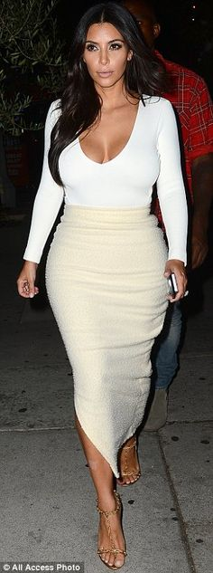 She can't resist: Kim was showcasing plenty of cleavage in the ensemble, and playfully tossed her hair about
