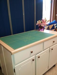 Cutting table in middle of room with design wall behind it. I had the screens and hubby mounted them on the wall. Can use a piece of flannel and it will work just as well for a design wall Kitchen Cupboards, Kitchen Sink, Low Cabinet, Wall Design, Screens, Flannel, Middle, Sewing, Storage