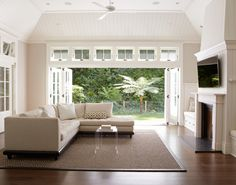 Transom windows over sliding folding glass patio doors
